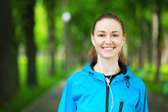 Cheerful young woman ready to start her morning workout. Stock Photos