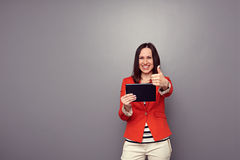 Woman showing thumbs up Royalty Free Stock Image