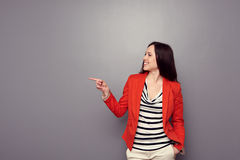 Woman pointing at empty copyspace Stock Photo
