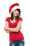 Cheerful young woman in red santa's hat Royalty Free Stock Image