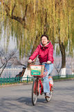 Cheerful young woman on a rental bike, Hangzhou, China Stock Images