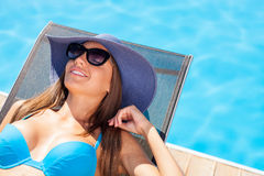 Cheerful young woman is resting on the sun Stock Image