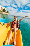 Cheerful young woman riding catamaran Royalty Free Stock Image