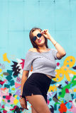 Cheerful young woman with round glasses posing royalty free stock image