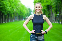 Cheerful young woman before a running session. Stock Images