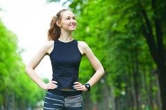 Cheerful young woman before a running session. Stock Photography
