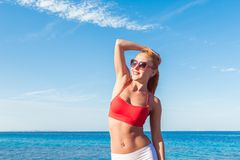 Cheerful young woman at the sea Royalty Free Stock Photography