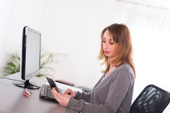 Cheerful young woman secretary working with computer Royalty Free Stock Photos