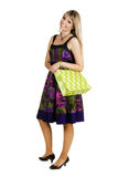 Cheerful young woman with shopping bag Royalty Free Stock Photo
