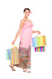 Cheerful young woman with shopping bags Royalty Free Stock Photo