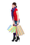 Cheerful young woman with shopping bags Royalty Free Stock Photos