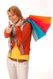 Cheerful young woman with shopping bags Royalty Free Stock Images