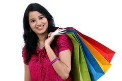 Cheerful young woman with shopping bags Stock Image