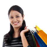 Cheerful young woman with shopping bags Royalty Free Stock Photography