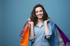 Cheerful young woman shopping stock image
