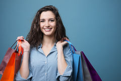 Cheerful young woman shopping Stock Images
