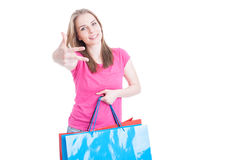 Cheerful young woman showing number three or third Royalty Free Stock Photos