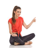 Cheerful young woman showing thumb up Royalty Free Stock Images