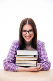 Cheerful young woman sitting at the table with books Royalty Free Stock Photo