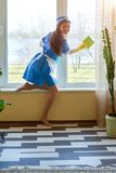 Pretty housemaid smiling. Royalty Free Stock Image