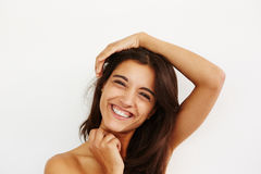 Cheerful young woman smiling against white background Stock Image
