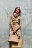 Cheerful young woman smiling with bags Stock Photography