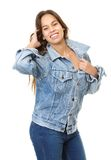 Cheerful young woman smiling with hand in hair Royalty Free Stock Photos