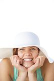 Cheerful young woman smiling with hat Stock Photography