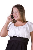 Cheerful young woman smiling on the phone Stock Photos