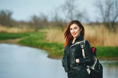 Cheerful young woman on spring walk stock images