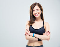 Cheerful young woman standing with arms folded Royalty Free Stock Image