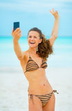 Cheerful young woman taking self photo on beach Royalty Free Stock Image