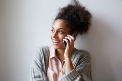Cheerful young woman talking on mobile phone Stock Photo