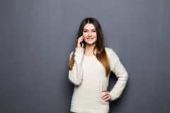 Cheerful young woman talking on mobile phone Royalty Free Stock Photo