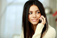 Cheerful young woman talking on phone Stock Photos