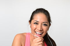 Cheerful young woman talking to hands-free set Royalty Free Stock Image