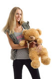 Cheerful young woman with teddy bear Royalty Free Stock Photo