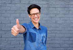 Cheerful young woman with thumbs up hand gesture Royalty Free Stock Photo