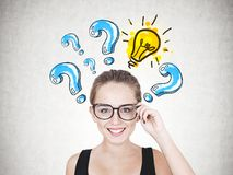 Smiling young woman in glasses, answer idea stock image