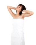 Cheerful young woman in towel with raised arms Royalty Free Stock Photography