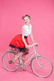 Cheerful young woman is traveling by cycle Stock Photos