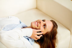 Cheerful young woman using a cellphone Royalty Free Stock Photos