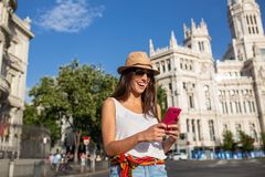 Young woman using phone in Madrid, Spain Royalty Free Stock Image