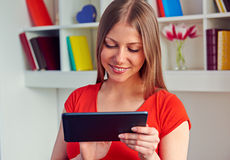 Young woman using the tablet pc royalty free stock photo