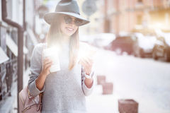 Cheerful young woman walkign in the street Royalty Free Stock Photo
