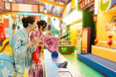 Cheerful young woman wearing traditional kimono stock photo