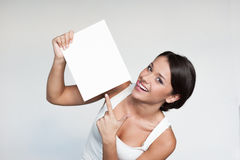 Cheerful girl holding sign Royalty Free Stock Photos