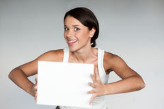 Cheerful girl holding sign Stock Photo
