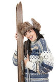 Cheerful young woman with old wooden skis Stock Image
