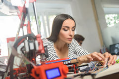 Cheerful young woman working with 3d technology Royalty Free Stock Photos